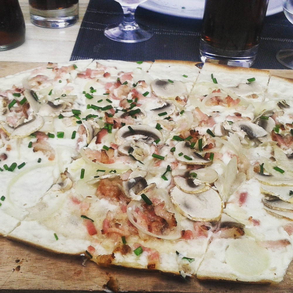 Tarte flambée with bacon, onions and mushrooms in Strassbourg, Alsace