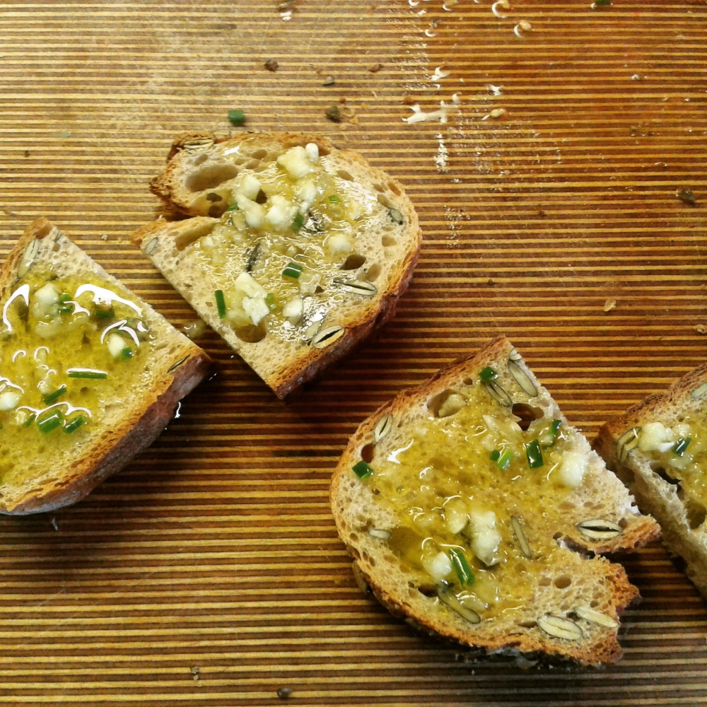Bread topped with olive oil, garlic and herbs.